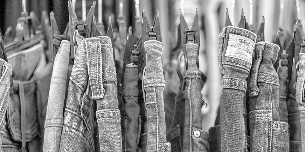 jeans on rail in traid shop